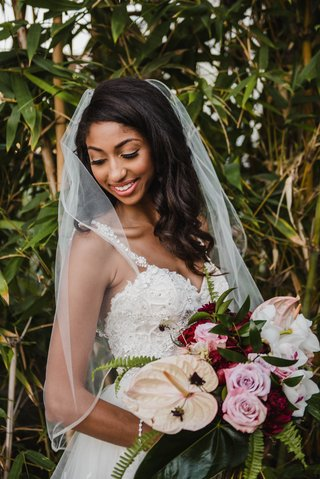 modern-tropical-bridal-bouquet-with-burgundy-flowers-pink-roses-laceleaf-orchids-ferns