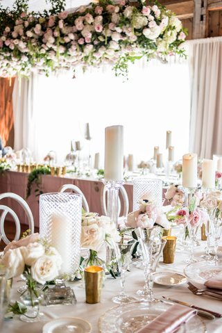 reception-tables-with-pillar-candles-in-textured-hurricanes-and-on-stands