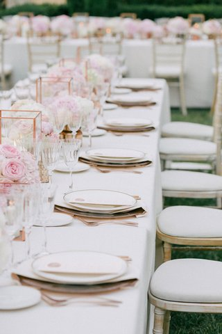 wedding-reception-on-grass-lawn-outdoor-white-chairs-whitewash-and-long-table-pink-flowers-rose-gold