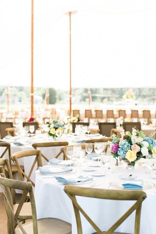 wedding-reception-round-table-white-linen-wood-chair-cross-back-x-blue-napkin-low-centerpiece-flower