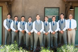 groom-and-groomsen-in-grey-vests-pants-navy-blue-ties-at-the-ranch-at-laguna-beach