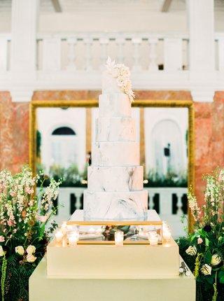 mariana-paola-vicente-and-kike-hernandez-wedding-cake-marble-design-white-sugar-flowers-ballroom