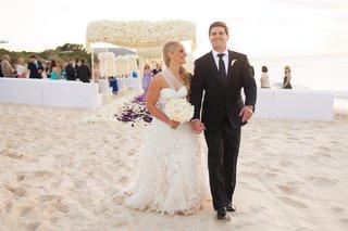 bride-and-groom-exit-beach-ceremony-in-turks-caicos