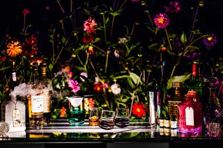 alice-in-wonderland-inspired-shoot-bar-with-potions-decanter-with-dried-ice-that-says-drink-me