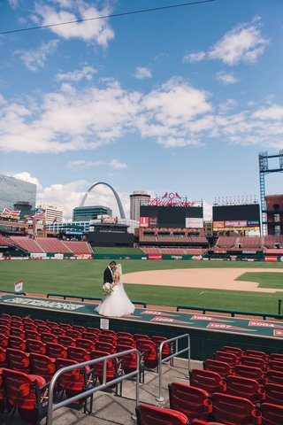 wedding-portrait-couple-photo-at-busch-baseball-stadium-in-st-louis-with-gateway-arch-in-background