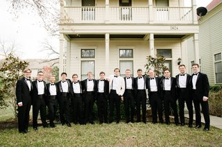 groomsmen-in-tuxedos-and-groom-in-white-jacket-for-new-years-eve-wedding-in-texas