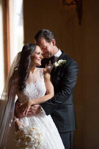 bride-in-ines-di-santo-illusion-wedding-dress-ball-gown-groom-tuxedo-bow-tie-new-york-city-wedding