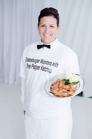 female-catering-server-with-personalized-t-shirt-and-bow-tie