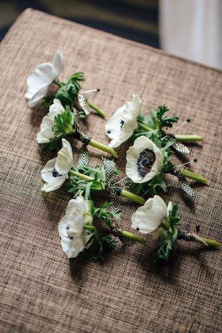 white-and-black-anemone-flower-boutonniere-for-groomsmen-chevron-diamond-ribbon