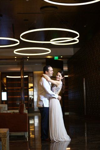 couple-embracing-during-rehearsal-dinner-love-dominican-republic-wedding-marriage-formal-inspiration