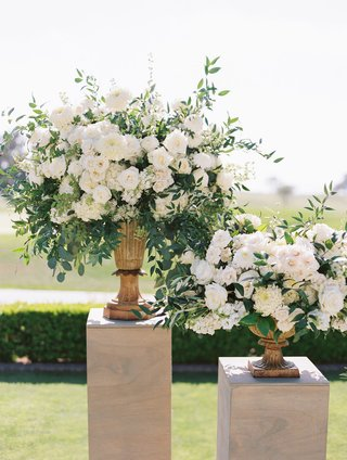 wedding-ceremony-at-the-lodge-at-torrey-pines-white-rose-flowers-greenery-urns-wood-risers