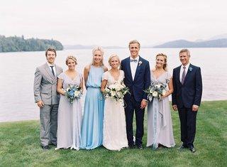 bride-in-carolina-herrera-wedding-dress-with-groom-in-tuxedo-by-lake-with-marriott-family-bridesmaid