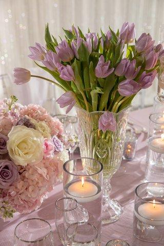 wedding-reception-low-centerpiece-purple-tulip-flowers-next-to-floating-candles-low-centerpiece