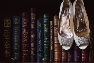 pair-heels-displayed-books-shelf-badgley-mischka-vintage-library-art-modern-white