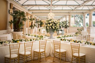 bellagio-las-vegas-wedding-reception-four-long-tables-form-an-x-with-flower-arrangement-in-middle