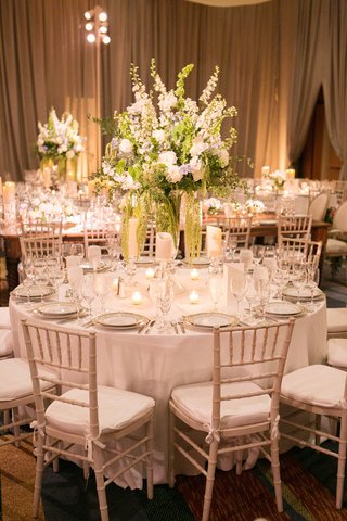 white-dinner-furniture-topped-with-tall-centerpiece