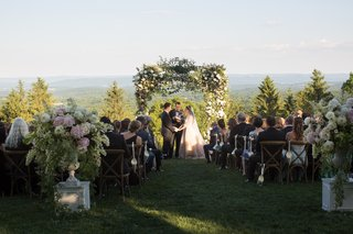 mountain-forest-wedding-ceremony-with-arbor-of-greenery