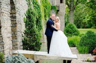 wedding-portrait-at-greenacres-arts-center-in-cincinnati-ohio-groom-in-midnight-blue-suit-bride