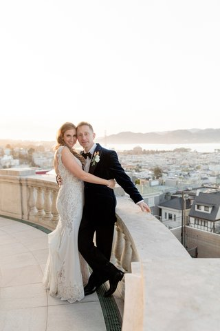 james-leary-flood-mansion-san-francisco-wedding-bride-and-groom-on-balcony-overlooking-san-francisc