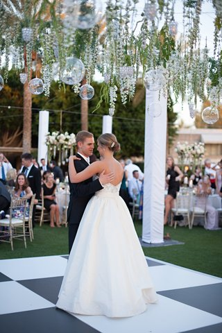 bride-in-a-strapless-anne-barge-dress-dances-with-groom-in-tuxedo-arizona-biltmore