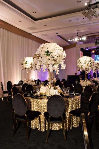 wedding-anniversary-party-reception-white-rose-orchid-flowers-gold-sequin-linen-black-velvet-gold