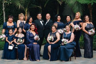 same-sex-wedding-inspiration-gay-wedding-with-large-group-of-groomsmaids-in-navy-dresses
