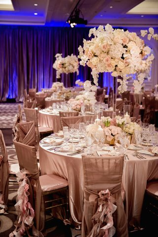 round-table-topped-with-ivory-floral-centerpiece