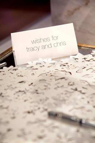 wedding-reception-with-table-for-guests-to-write-wishes-on-paper-snowflakes