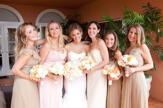 bride-with-girlfriends-wearing-floor-length-gowns