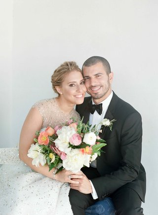 bride-in-sparkle-dress-and-groom-in-tuxedo-with-bouquet