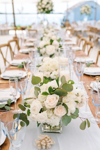 head-table-with-small-centerpieces-down-the-middle-with-rose-and-eucalyptus-leaves