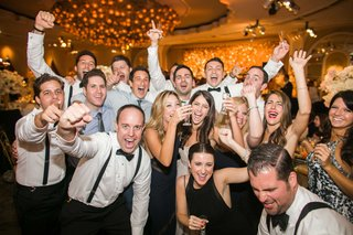 wedding-guests-dancing-drinking-being-merry-at-wedding-reception-in-beverly-hills-hotel