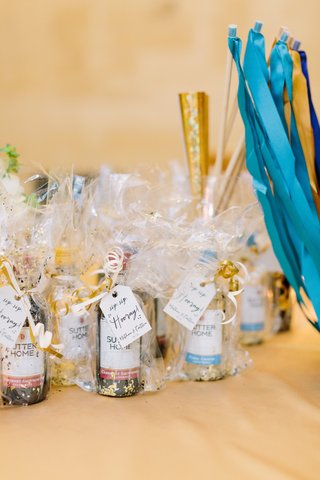 mini-wine-bottles-as-wedding-favors-with-confetti-sip-sip-hooray