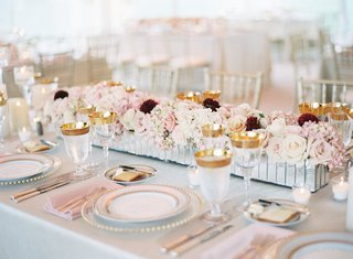 wedding-centerpiece-mirror-trough-with-low-flower-arrangements-roses-white-pink-burgundy