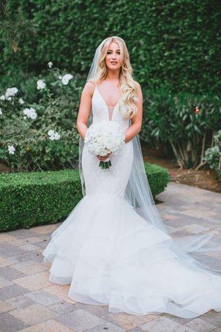 bride-with-long-blonde-hair-veil-white-bouquet-mermaid-wedding-dress-horsehair-trim-lazaro