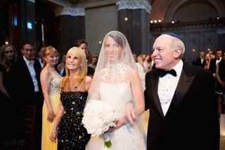 mother-of-bride-and-father-of-bride-walks-bride-down-aisle