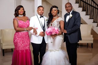 wedding-photo-of-bride-and-groom-with-mother-and-father-mother-in-hot-pink-dress-with-choker