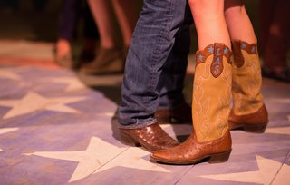 cowboy-boots-with-brides-monogram-at-welcome-party