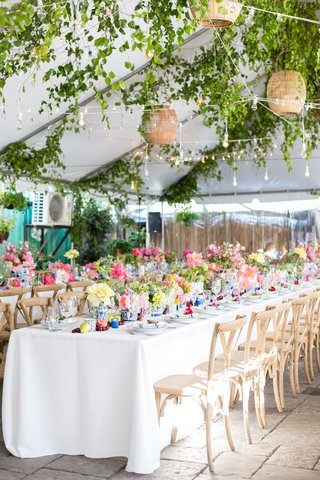 tented-rehearsal-dinner-with-bistro-lights-above-the-tables