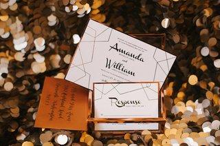 a-contemporary-style-invitation-with-a-white-black-and-copper-color-scheme