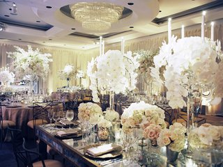 ballroom-wedding-with-drapery-walls-white-orchid-candle-centerpieces-rose-hydrangea-centerpieces