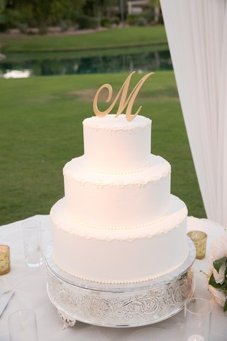 white-wedding-cake-with-gold-initial-topper