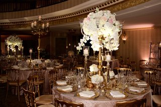 round-reception-table-with-tablecloth-and-tall-centerpiece-flower-arrangement-white-hydrangea-orchid