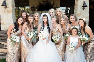 bride-in-monique-lhuillier-wedding-dress-and-veil-with-flower-girl-and-bridesmaids-in-gold-gowns