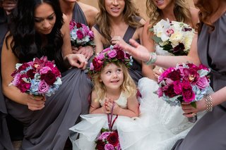 bridesmaids-in-grey-dresses-surrounding-flower-girl-with-flower-crown