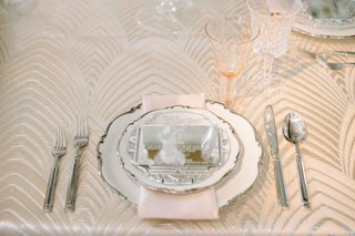 ornate-china-with-silverware-and-engraved-mirror-as-menu