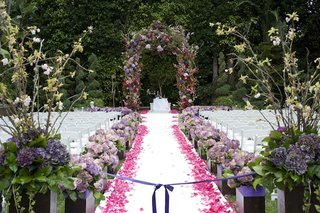 floral-embellished-arch-and-petal-lined-aisle