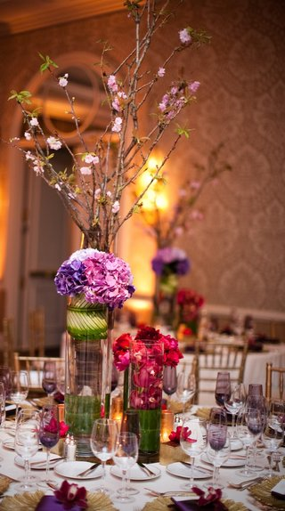 purple-champagne-glasses-and-towering-centerpieces
