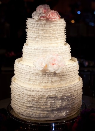 four-layer-white-round-cake-with-sugar-florals