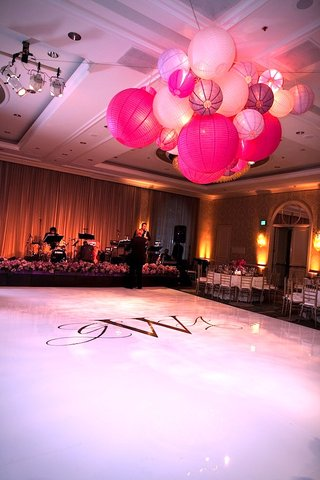wedding-monogram-on-white-floor-in-front-of-stage
